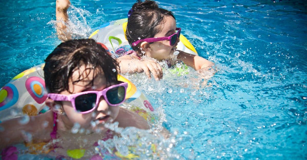 pool fun -2 kids kicking water