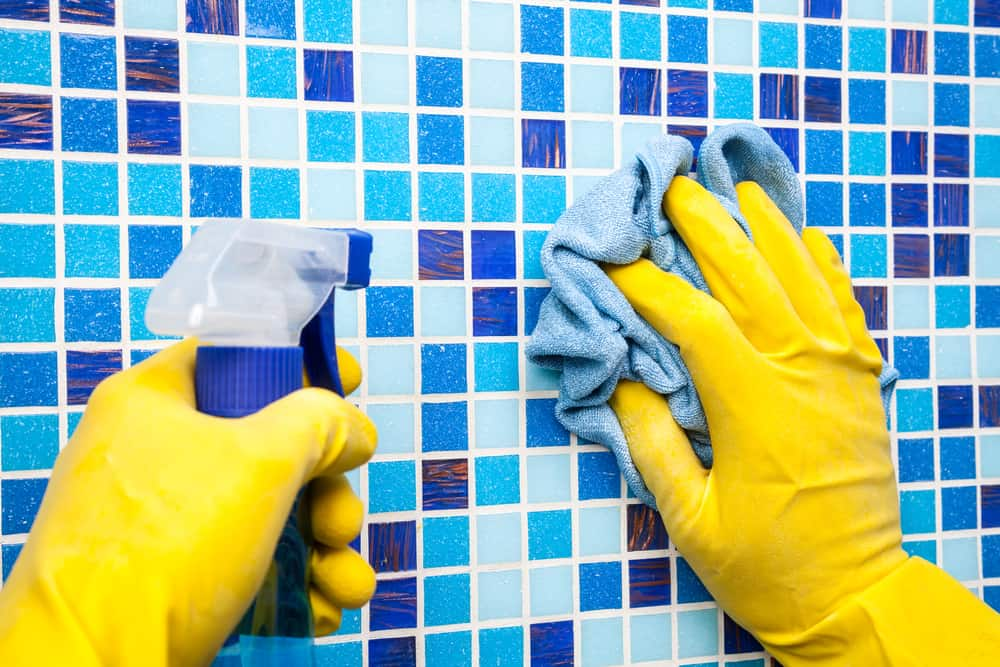 Scrubbing pool tiles by hand